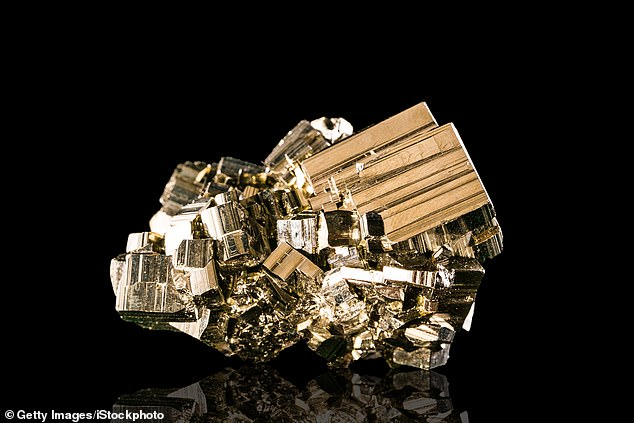 There is trace, almost 'invisible' amounts of gold in pyrite, also known as 'fool's gold'