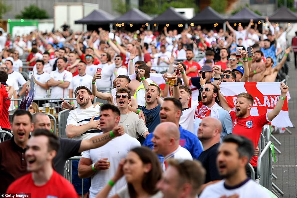 England supporters sing the national anthem with their hands on their hearts in Manchester ahead of the match