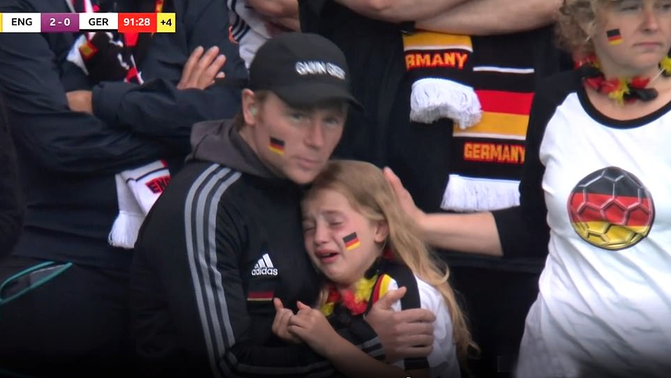 German fans were left in tears after England knocked their team out of the Euros on Tuesday. Pictured: A girl cries at Wembley as the nations hopes of going through to the quarter finals ebb away