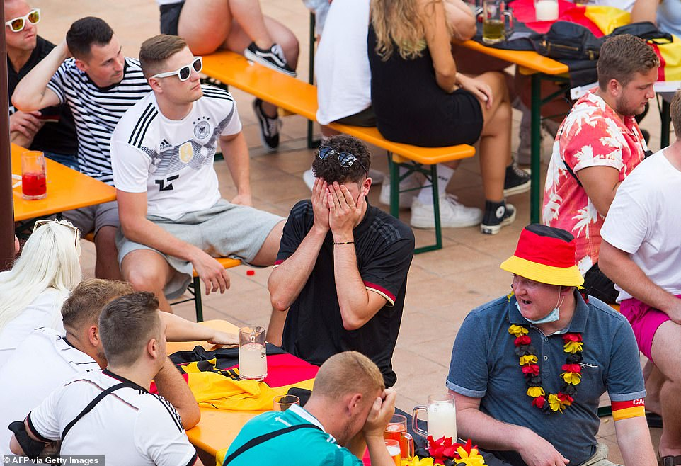 Pictured: A German fan sits with his head in his hands while watching his team lose to England on Tuesday