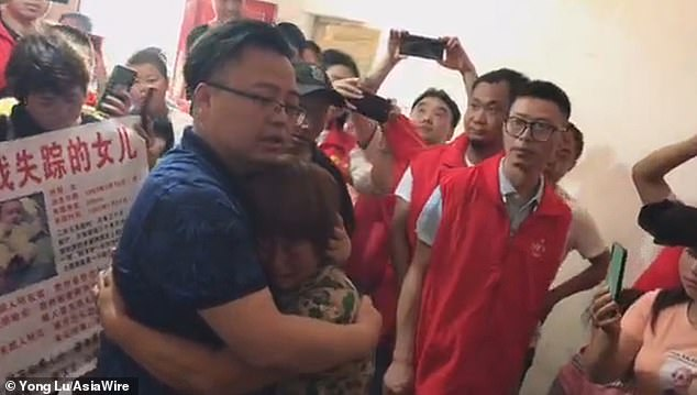 Tao Xiaobing (left) was miraculously reunited with his mother (middle) in the city of Bijie in the Chinese province of Guizhou on June 26