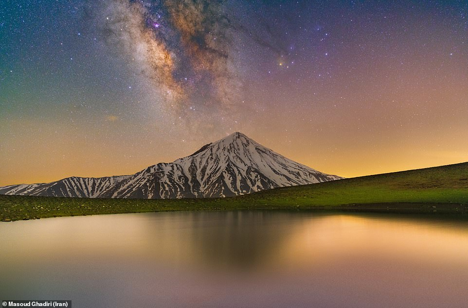 Glory of Damavand and Milky Way is an image by Masoud Ghadiri and shows the Milky Way appearing to come out of Mount Damavand