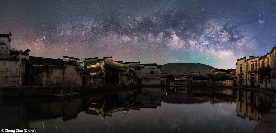 Ythe Ancient Villageof Hongcun near the Huangshan Mountain in China dates back over 900 years and was captured with the Milky Way backdrop by Zhang Xiao