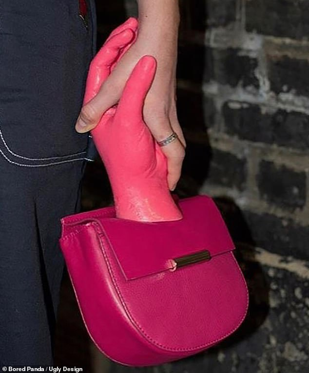 Putting the 'hand' in 'handbag; this handle on this clutch is made to look like a pink hand reaching out