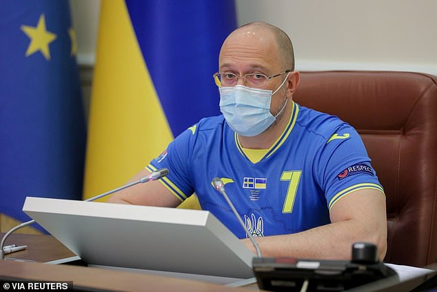 Prime Minister Denys Shmyhal (pictured) wore a blue and yellow football jersey at the meeting of the Government in Kyiv, Ukraine, on Wednesday following the Ukraine team's victory. He was wearing the shirt ofAndriy Yarmolenko, who plays for West Ham