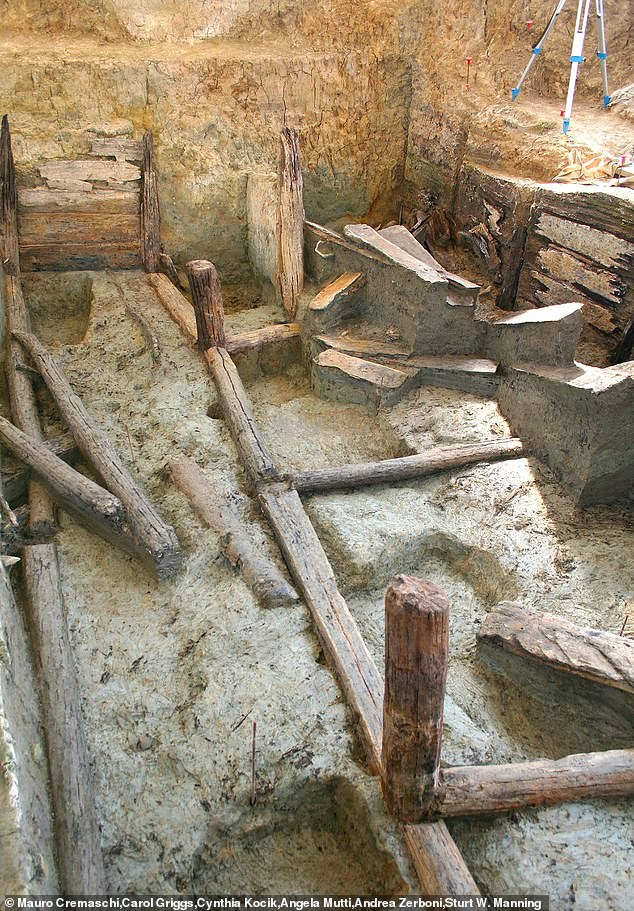 Wooden poles, beams and boards formed the exterior of the pools and strengthen the walls of the deep pit that once held water