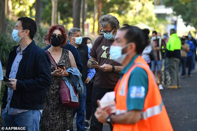 Prime Minister Scott Morrison has come under fire for the glacial vaccine rollout. Pictured: Queues outside at a mass COVID-19 vaccination hub in Sydney