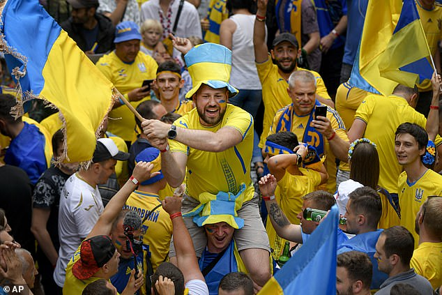 The England fans living in Europe were able to buy their tickets on social media from Brits living in the UK who will have to watch the game against Ukraine from their home or beer gardens. Pictured: Ukraine fans before their match against Austria on June 21