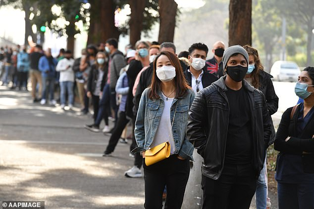 A long line formed outside the NSW Vaccination Centre in Sydney, with all of those waiting wearing face masks