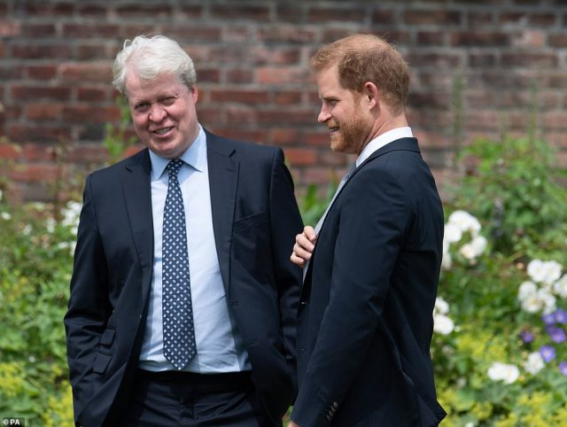 In good spirits: Earl Spencer, who oversees the family estate of Althorp, smiled as he chatted to Prince Harry today