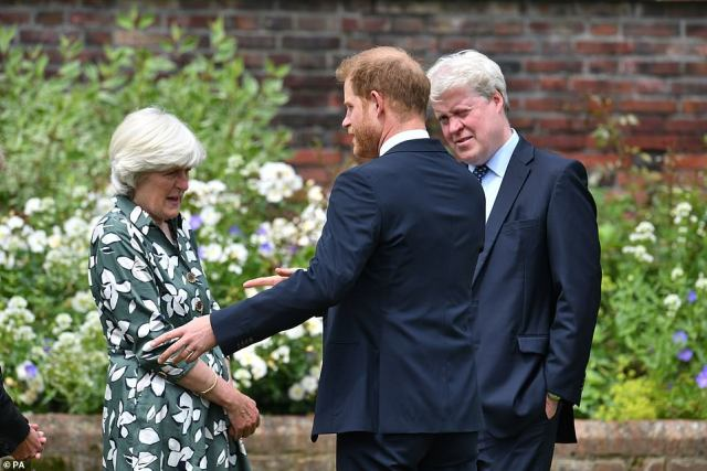 Prince Harry could be seen chatting withLady Jane Fellowes and uncle Earl Spencer, at the unveiling of a statue of his mother Diana today