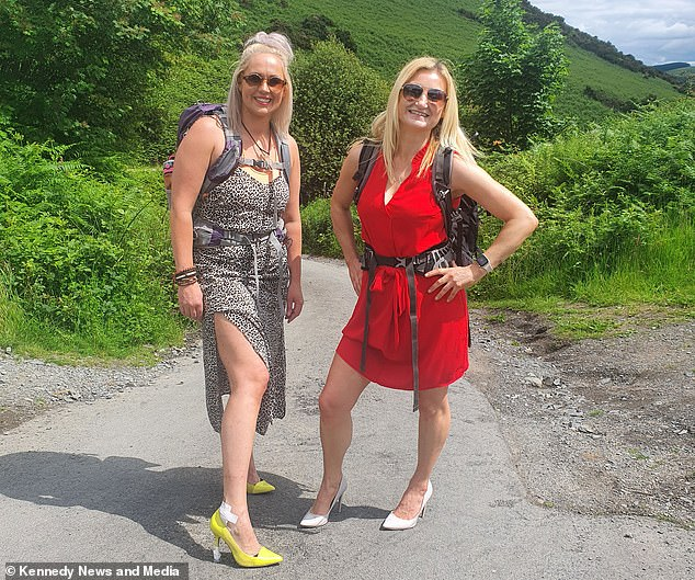 Emma Woodhall, 35, and Corinne Murray, 42, ditched their usual hiking attire to tackle the famous Wainwright Blencathra in Keswick, Cumbria, on Sunday