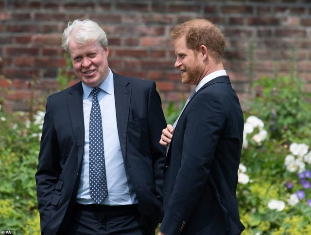 In good spirits: Earl Spencer, who oversees the family estate of Althorp, smiled as he chatted to Prince Harry