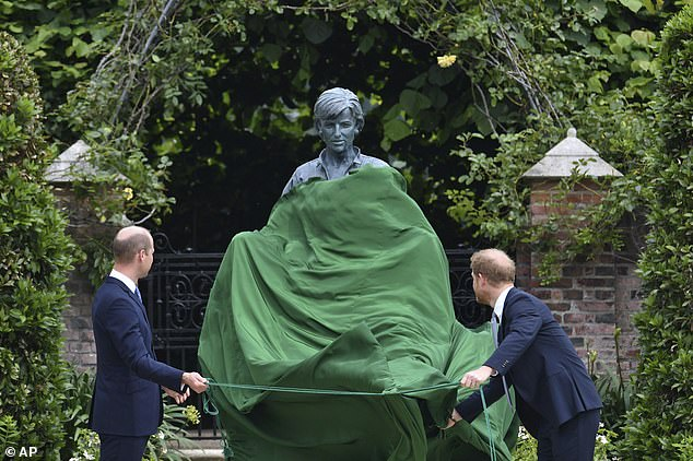 The brothers smiled as at the same time they pulled away the green cover to reveal the bronze sculpture by Ian Rank-Broadley