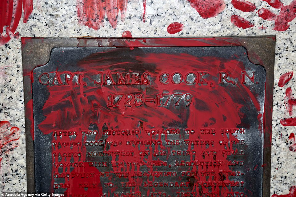 Red hand prints are seen on the statue of Capt. James Cook, who is branded a 'colonizer'