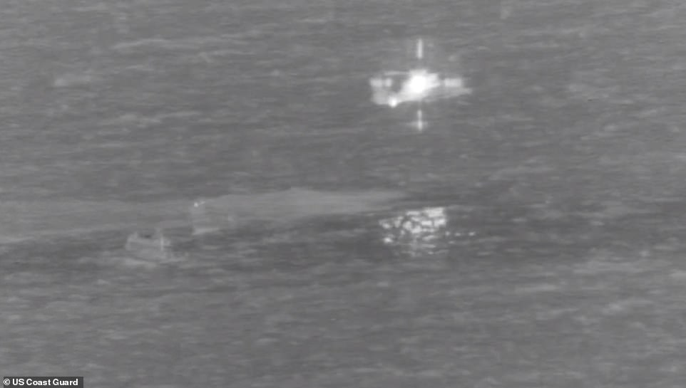 Images from the Coast Guard show the downed plane, and the helicopter (lit up) winching one of the pilots from the sea