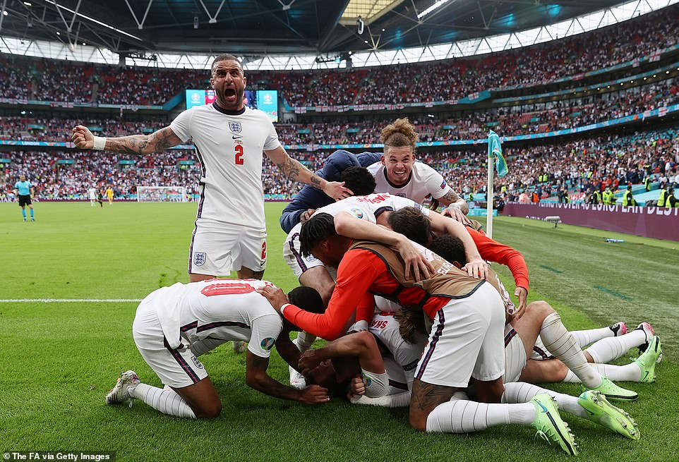 Can there be a better feeling than watching England beat Germany 2-0 at Wembley, after a pandemic that has lasted for a year and a half? (pictured, Harry Kane celebrates scoring the second goal against Germany)