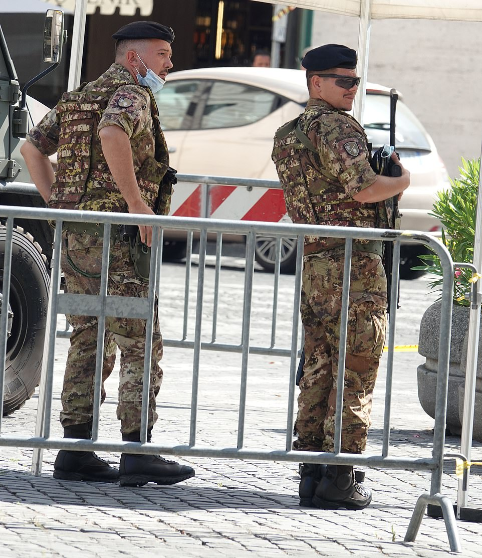 Plain clothed Italian police will wander among the crowds arriving for the match in Rome later today to carry out spot checks and ask for ID papers. Pictured: Security in Rome today