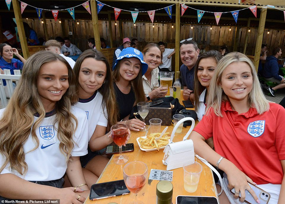 Fans across the country are set to watch the action outdoors on big screens in designated fan zones. Pictured: Smiling supporters in Newcastle's Times Square