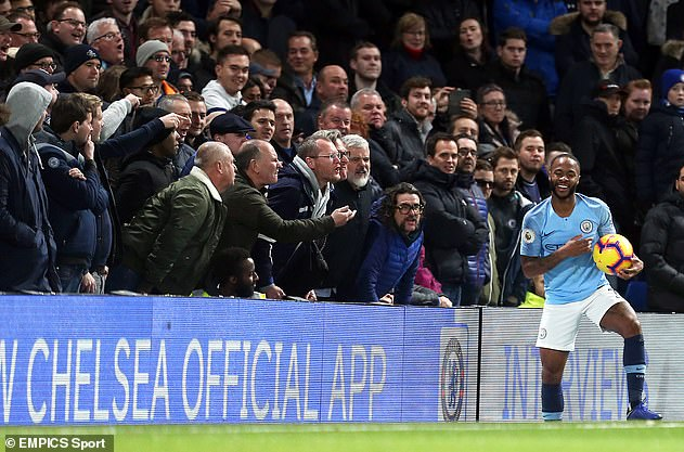 Chelsea fans are seen aiming abuse at Sterling at Stamford Bridge in December 2018