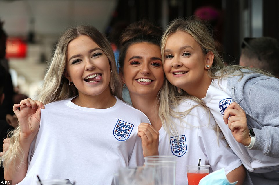 Hear our roar: England fans pose in Bristol as they prepare to cheer on the Three Lions in their quest for eternal footballing glory