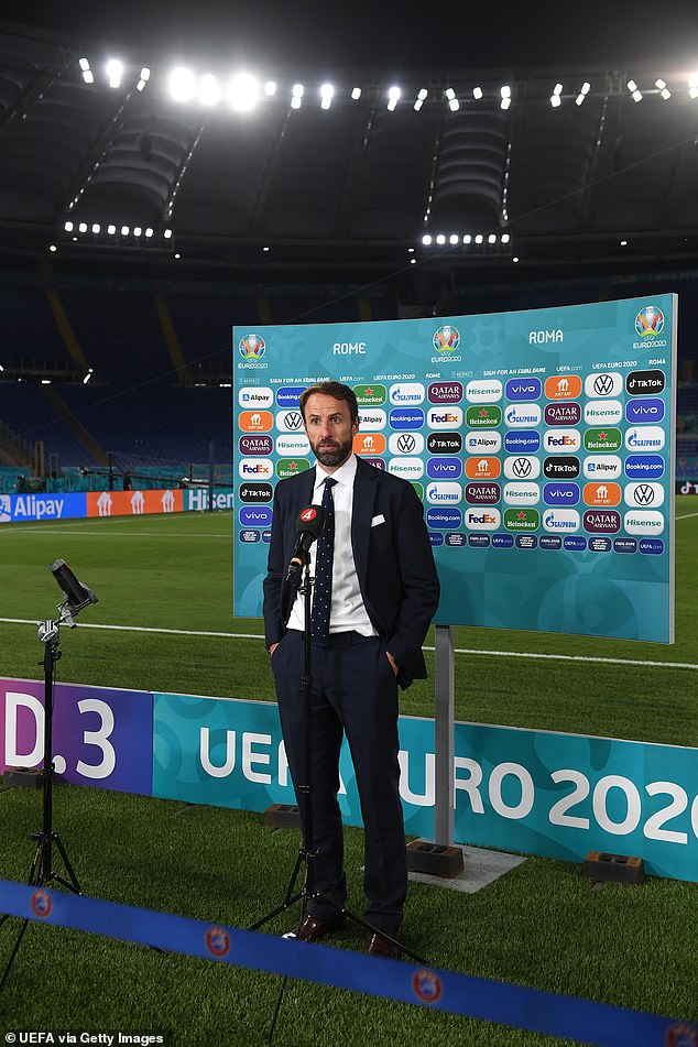 Touchline chic: Going for sartorial glory once again: Sales of waistcoats at M&S rocketed by 35 per cent after the World Cup in 2018 but Southgate told the Today programme on Radio 4 in May that the 'lucky' waistcoat wouldn't make a re-appearance at the Euros