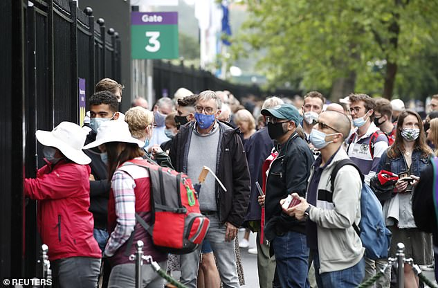 People wait in a queue outside Wimbledon before the start of play at All England Lawn Tennis and Croquet Club in London on June 28
