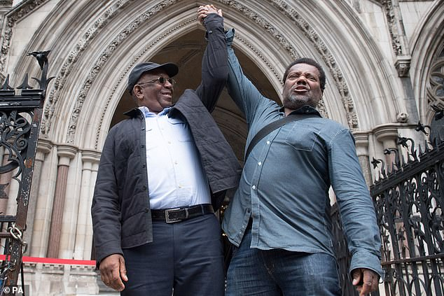 The British Transport Police has apologised toPaul Green (left) Cleveland Davidson (pictured outside the Royal Courts of Justice) and Courtney Harriot after their convictions were quashed
