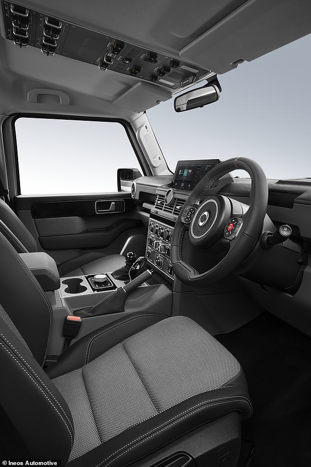 Several control switches are located in the ceiling to keep them from getting wet—and to keep the buttons on the dashboard to a minimum.