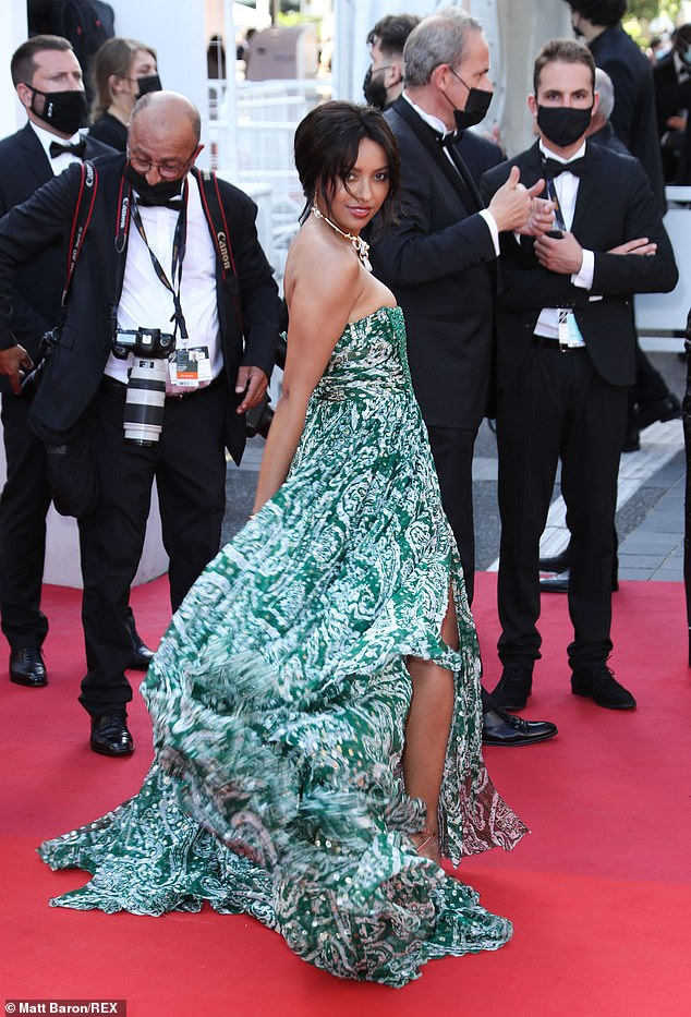 Picture perfect: The actress turned heads on the French red carpet as her patterned dress danced in the wind