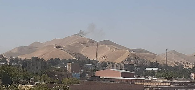 Pictures appeared to show smoke rising from the town of Qala-i-Naw after Taliban fighters launched an offensive against the provincial capital