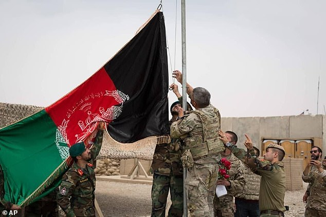 An Afghan flag israised during a handover ceremony from the US Army to the Afghan National Army, at Camp Anthonic, in Helmand province, southern Afghanistan in May 2021