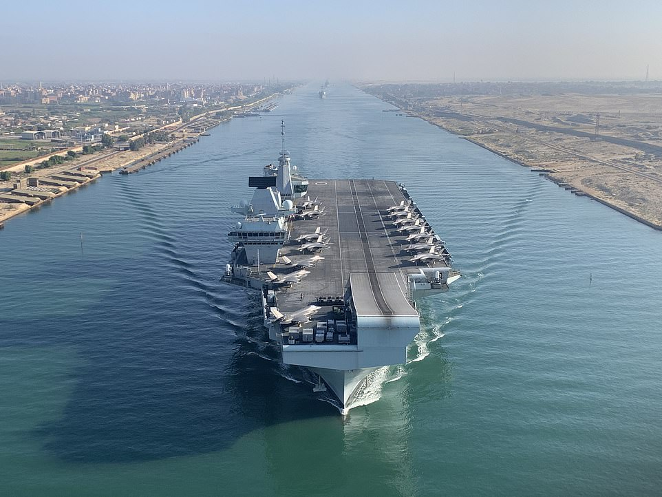 HMS Queen Elizabeth, Britain's largest aircraft carrier, has sailed through the Suez Canal for the first time during her maiden deployment alongside her carrier strike group