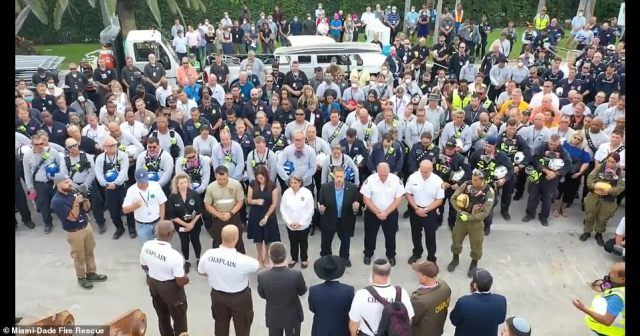 The workers held a moment of silence for the victims as they marked the transition in their operations from search and rescue to recovery