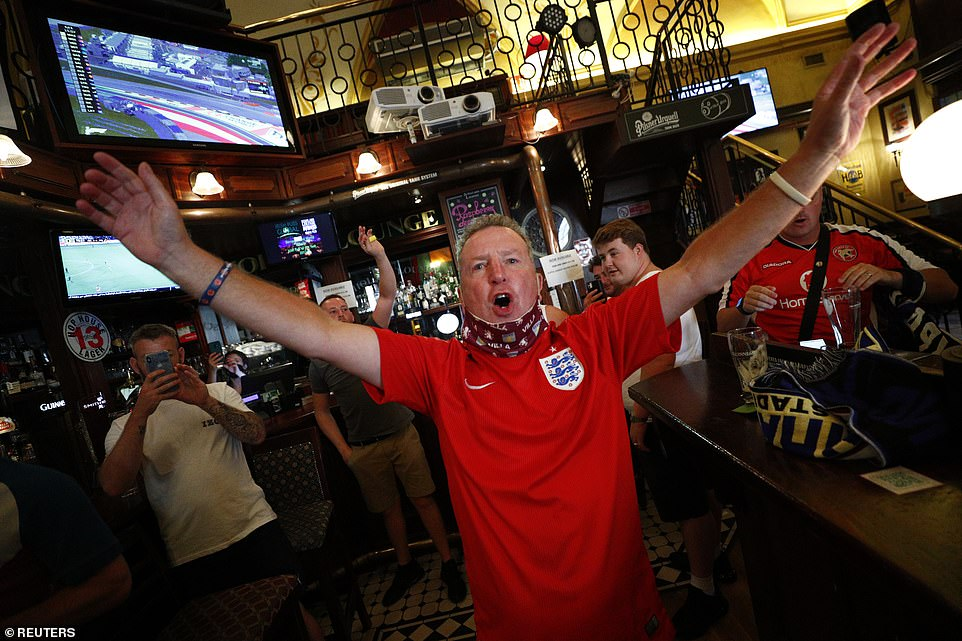 For fans, cheering is not just a way to release heart-felt emotions — they believe it is vital for rousing their team to victory and helps explain home-team advantages. Pictured: a fan cheering for England ahead of the Euro 2020 match against Ukraine