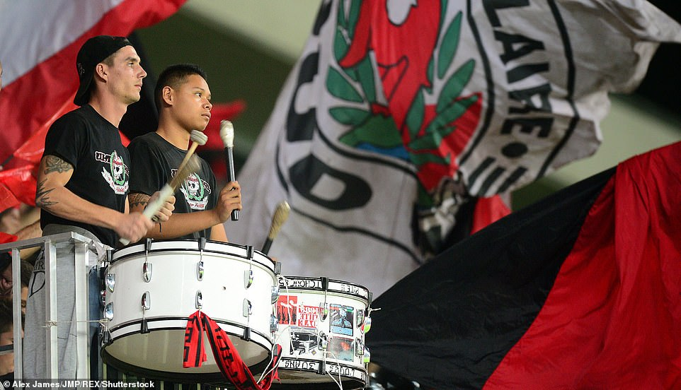 Banging the drums at a football match is a primitive method of creating music and aa 'social lubricant' within a community