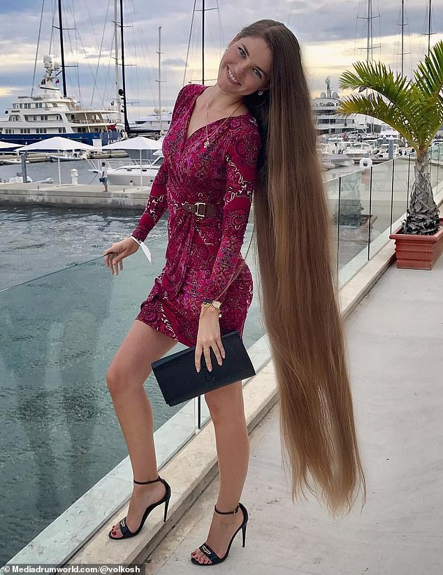Go for grow! Inga Volkosh, who is originally from Vladivostok, Russia, but now lives in Miami, Florida, gives her hair a slight trim twice a year, but otherwise has not cut her hair since age 14