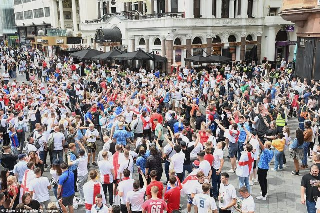 Football fans gather in Leicester Square and let off flares ahead of the Euros clash with Italy at Wembley