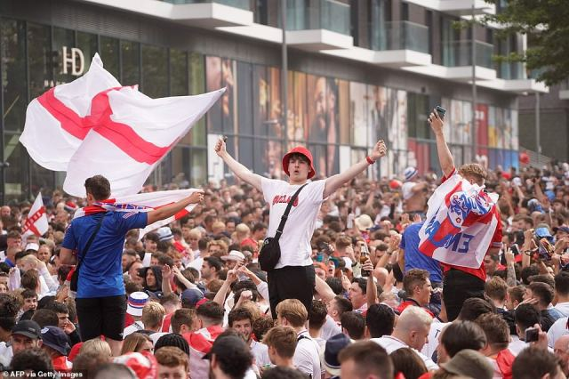 Thousands of England fans cheer on their team outside Wembley Stadium ahead of the UEFA EURO 2020 final football match