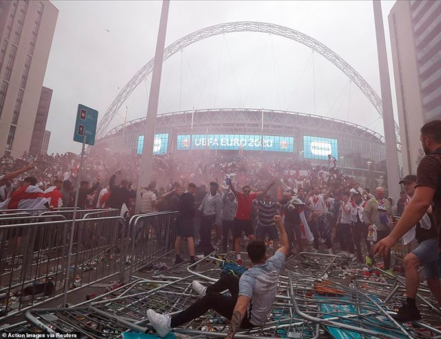 Riotous scenes outside Wembley as people crashed through barriers while celebrating the goal