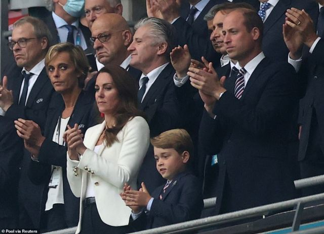 Prince George joined his parents in clapping England ahead of tonight's match - and soon became overwhelmed with excitement