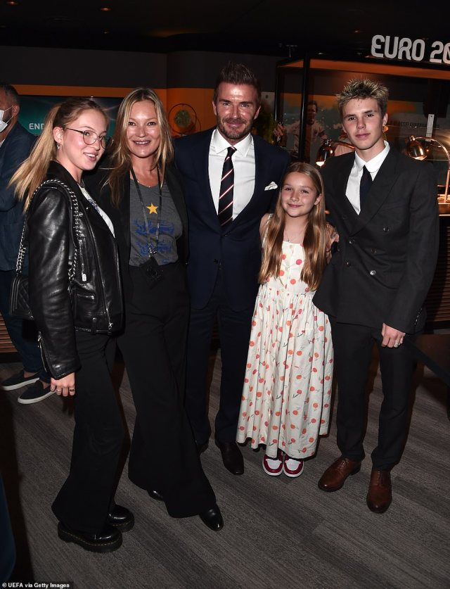 Fans: The former footballer, 46, was joined by Kate (second left) and her daughter Lila (left) to watch the match alongside his children Harper, ten, (second right) and Cruz, 16 (far right)