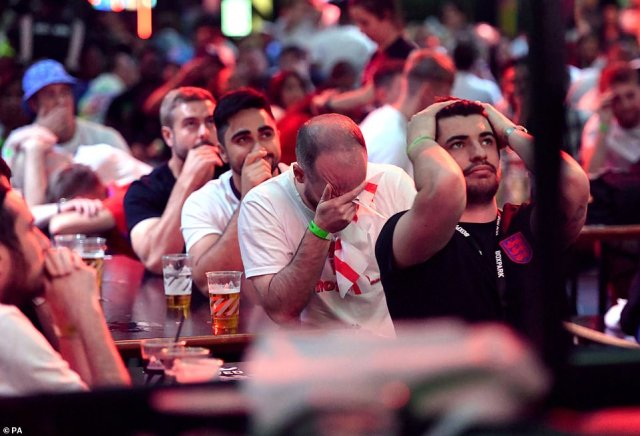 Distraught England fans put their heads in their hands as Italy deal a hammer blow after bossing the second half against England