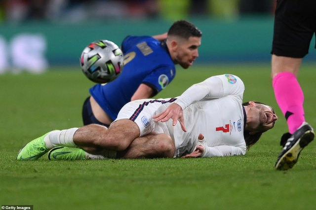 Grealish writhes in agony after a grubby challenge by Jorginho who raked his studs down the Englishman's shin