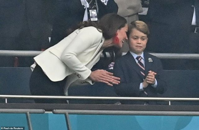 A beaming Kate spoke to her son as they watched the match at Wembley, in which England took an early lead