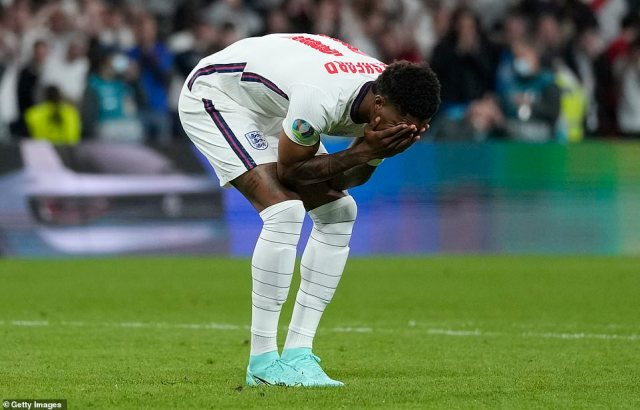 Marcus Rashford puts his face in his hands after missing his penalty by striking the post