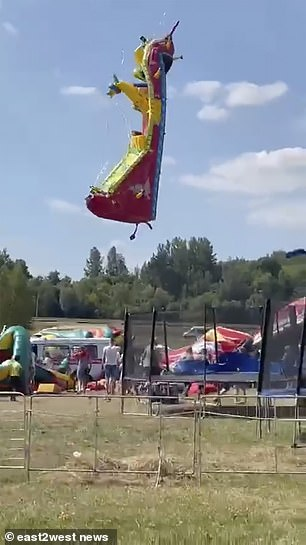 Another bouncy castle was lifted into the air