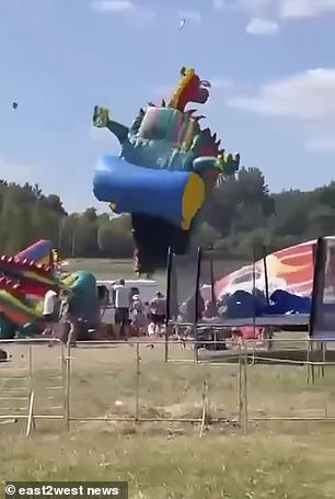 The bouncy castle was lifted into the air