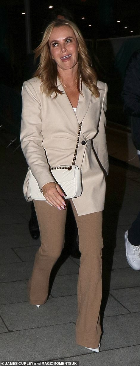 What loss? Amanda Holden rolled her eyes as she left the building