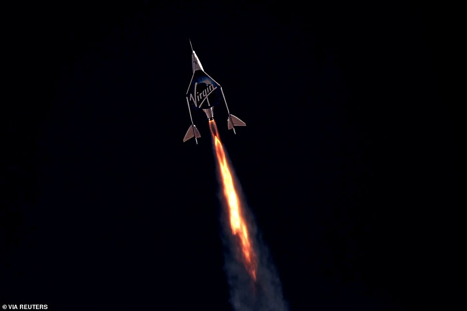 Virgin Galactic's passenger rocket plane VSS Unity, carrying Richard Branson and crew, begins its ascent to the edge of space